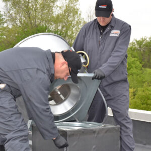 HOODZ technicians cleaning the outside of a kitchen exhaust vent