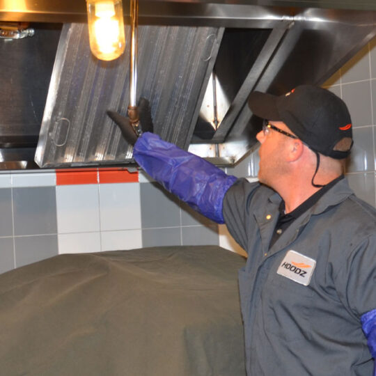 Hoodz technician performing vent hood filter cleaning