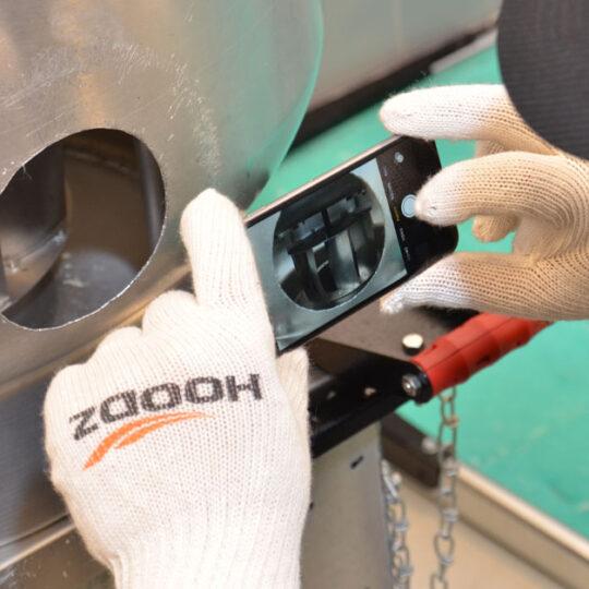 HOODZ technician inspecting an exhaust vent
