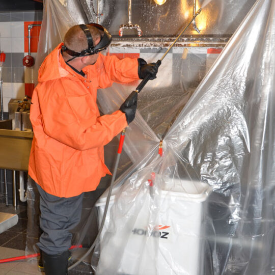 HOODZ Technician performing commercial kitchen cleaning