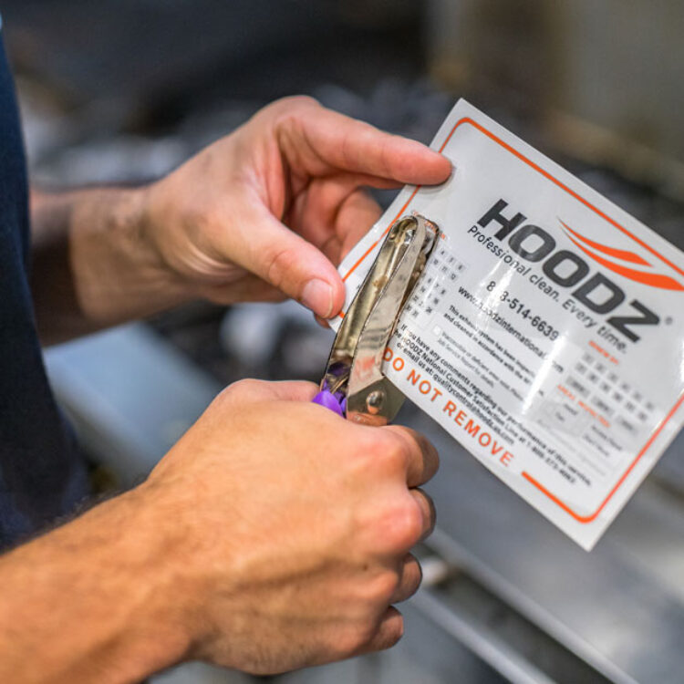 HOODZ leaves a service tag to keep track of regular cleanings