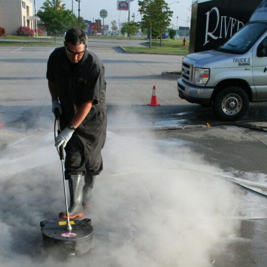 HOODZ technician providing professional concrete cleaning service
