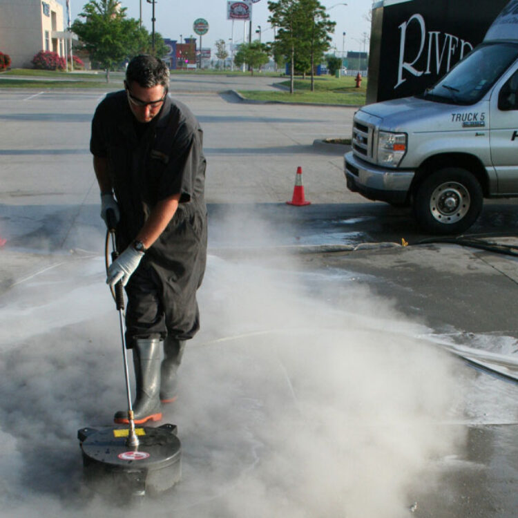 HOODZ technician providing professional concrete cleaning service