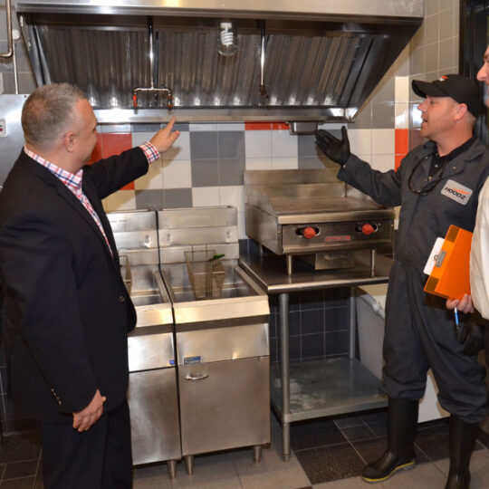 HOODZ inspecting a dirty kitchen exhaust hood